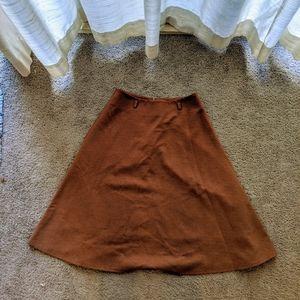 5/10$ Brown skirt.